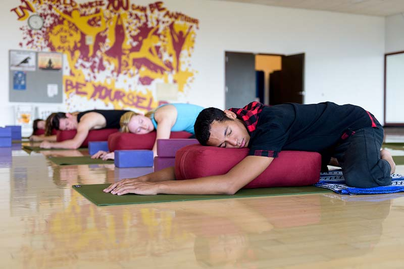 ASU students at the sun devil fitness complex doing yoga for wellness
