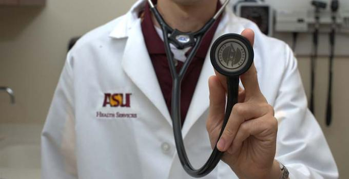 ASU doctor holding a stethoscope