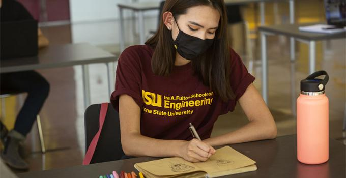 ASU student studying for class wearing a face mask