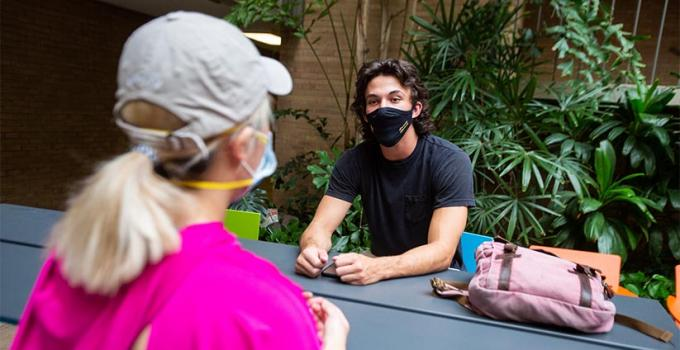 students discussing ASU elective class choices while wearing face coverings