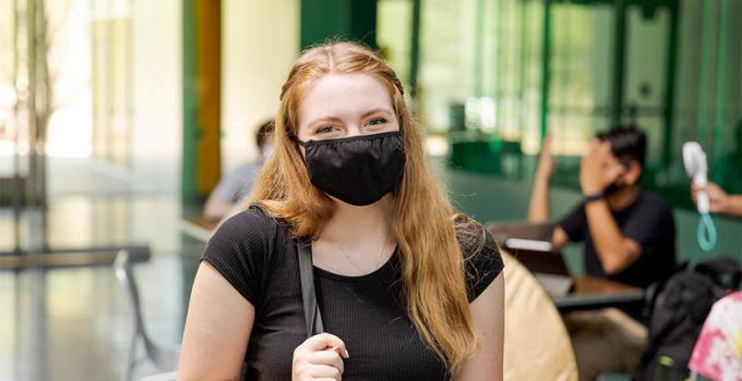 student on campus wearing a face mask