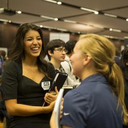 Student engaging at a career fair in college