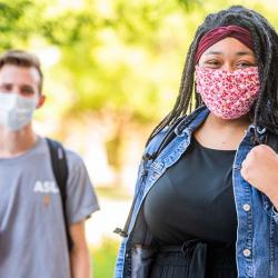 students on campus wearing face masks