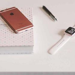 A book, journal, watch and pencil to help with time management