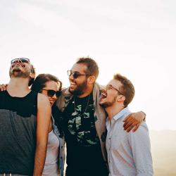 friends laughing in a group hug
