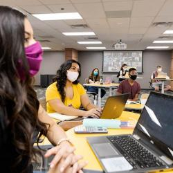 Students in a socially distanced classroom wearing face masks.